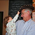 Isaac placing hat on Granddad