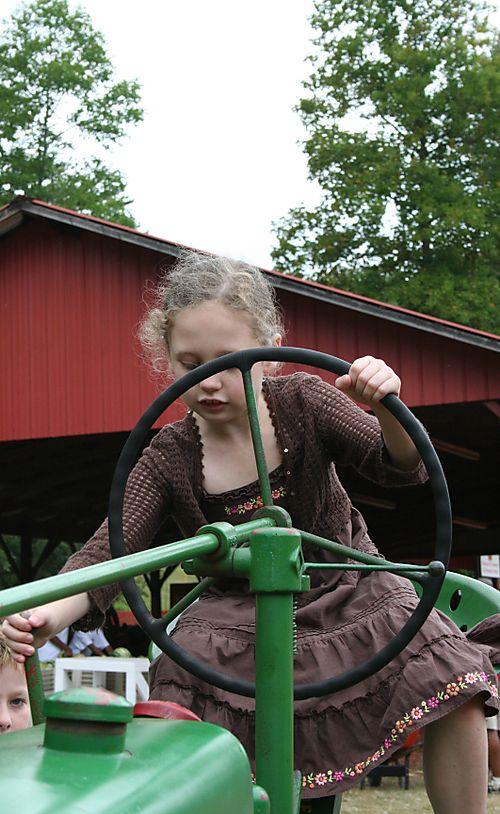 Olivia on tractor