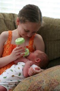 Olivia feeding joshua