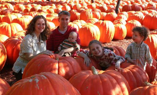 Family in pumpkins