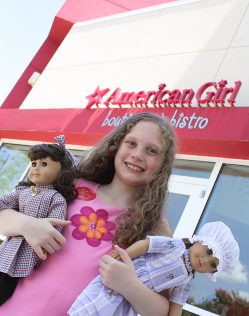 Olivia in front of american girl