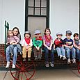 Kids on old train luggage cart