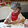 Isaac making a candy train