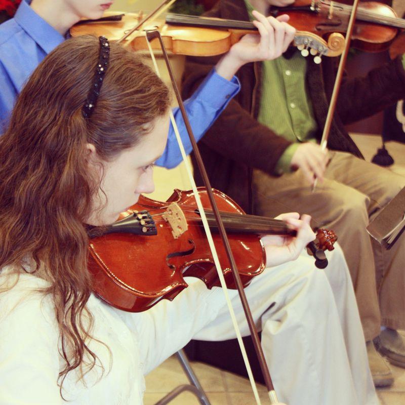 Olivia playing violin