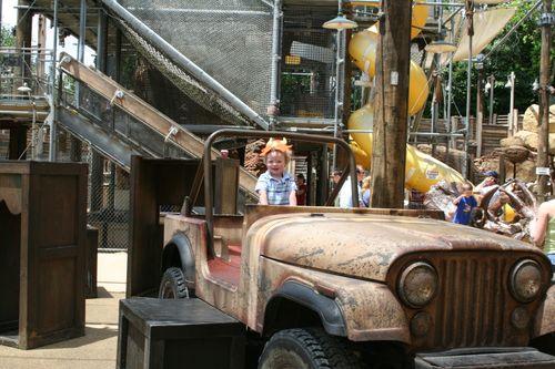 Isaac driving Jeep in Dinoland Maze