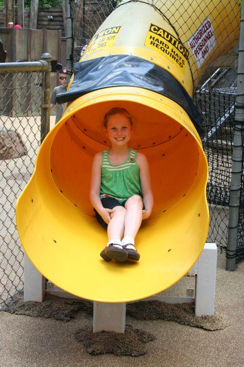 Olivia sliding in Dinoland Maze