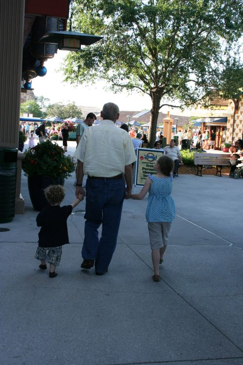 Olivia & Isaac walking with Granddad to Rainforest Cafe