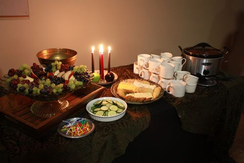 Fruit, cucumber slices, cheese and cracker platter, and tomato basil soup