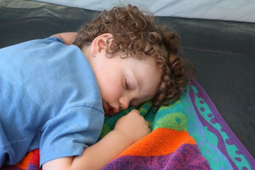 Isaac napping in tent