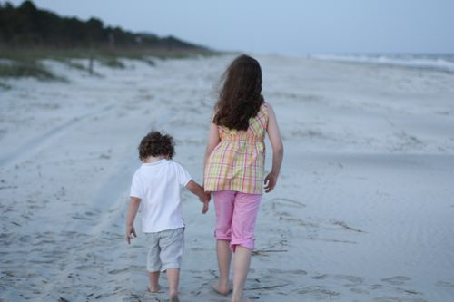 Olivia and Isaac walking on beach