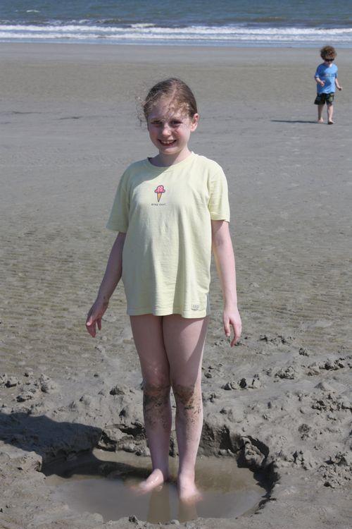 Olivia standing in tide pool
