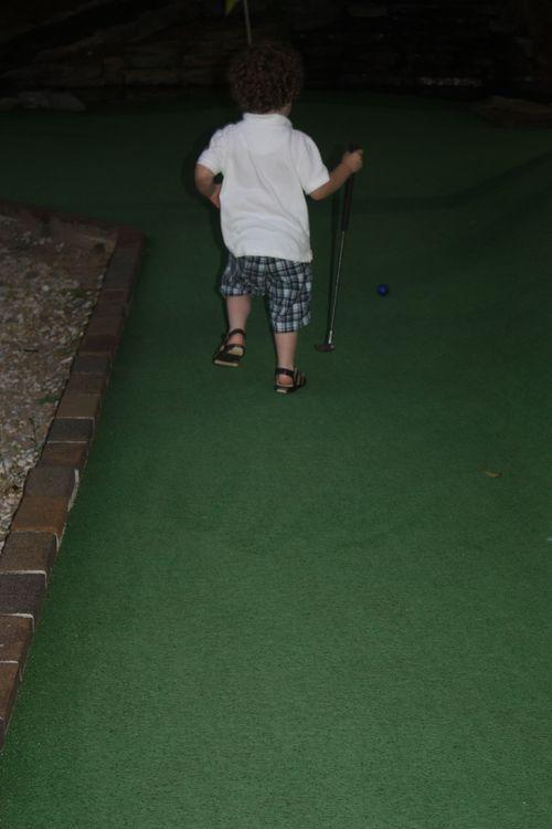 Isaac running on putt putt course