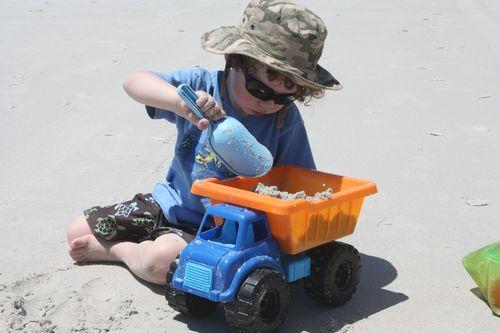 Isaac filling up his dump truck
