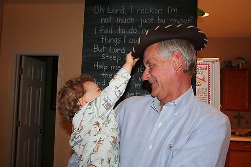 Isaac placing hat on Granddad