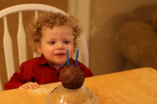 Isaac's blowing out his candles on his birthday