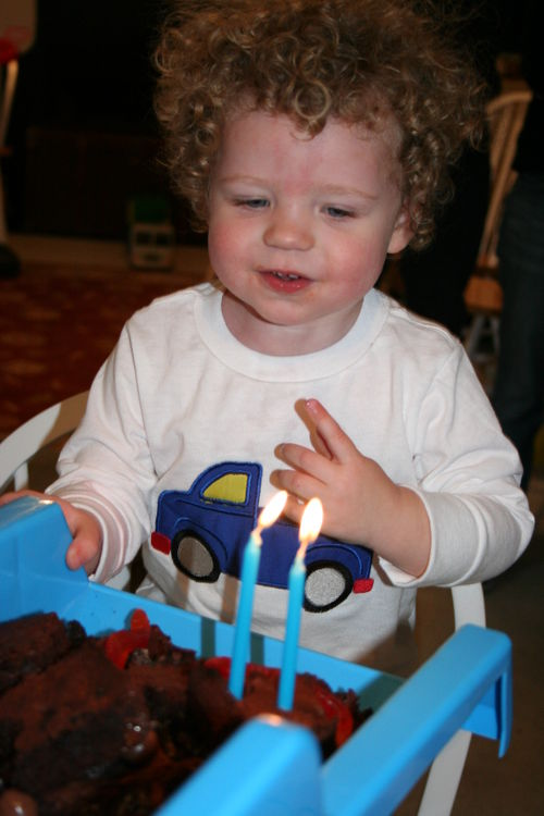 Isaac blowing out candles
