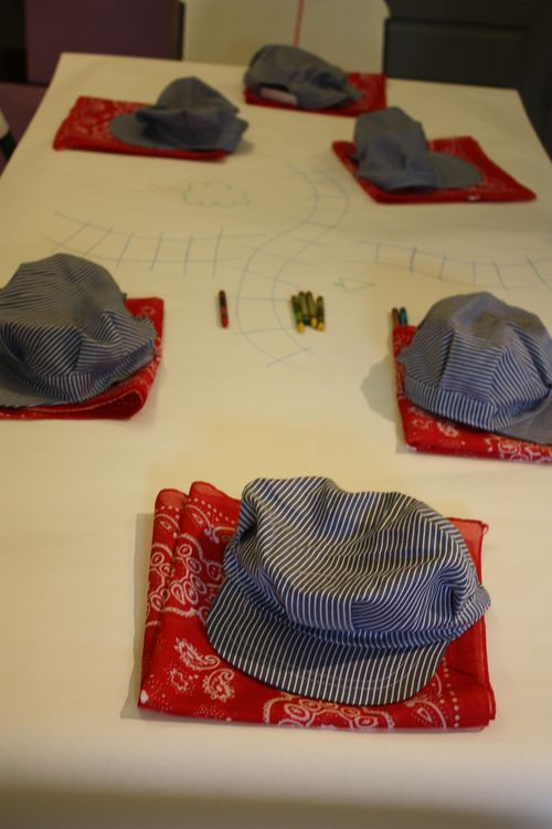 Table with bandanas and hats