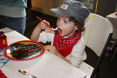 Isaac enjoying his cake and ice cream