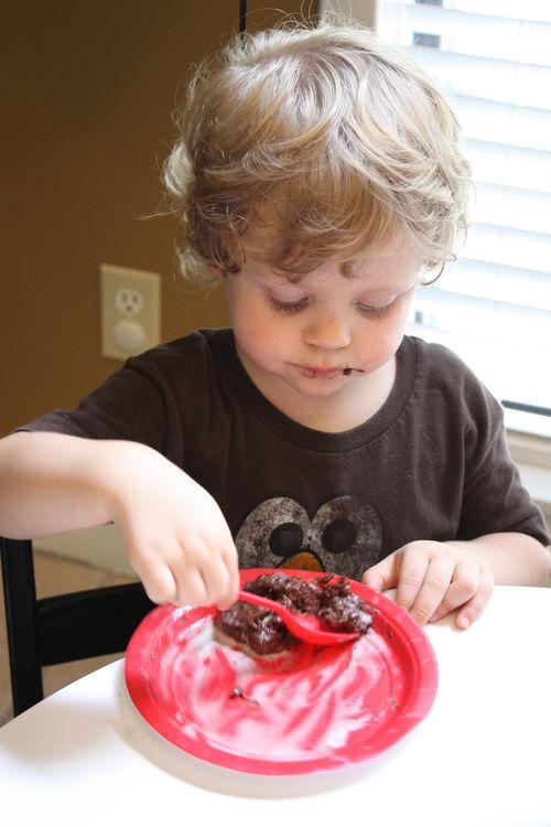 Birthday Boy enjoying his cake