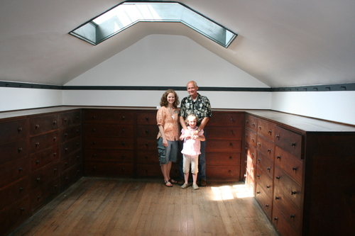 Dad, Ashley, and Olivia with chest of drawers