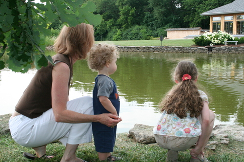 Mom, Olivia, & Isaac by koi pond
