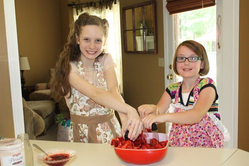 Olivia and friend making Strawberry Jam