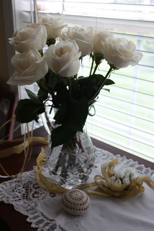 White roses in pitcher